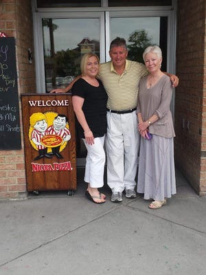 Kelly Munyan (left) and Nicholas Caggiano Jr., of Nicola Pizza, with Susan Hamadock, of Rehoboth Beach, in a picture Nicola posted online Tuesday.