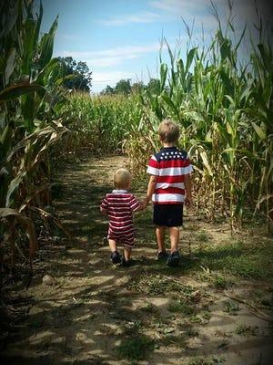 Ryan Johnson (left) and Daniel Johnson (right) walk through Skeeters corn maze adventure at Creative Works Farm in Waynesboro.
