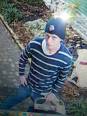 The suspect caught on camera stealing mail from houses in Newport, Kentucky.