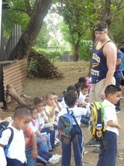 Port Huron's Alex Zmolik hangs out with children during his mission trip to Nicaragua last March.