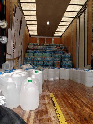 Water filled the truck quickly on Thursday before heading off to Flint.