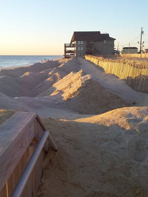 Sand piled up on frontal dune in Ortley Beach section of Toms River. Looking south towards Seaside Heights.