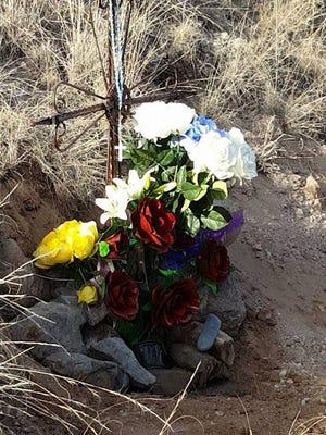 Friends of Jose Garcia created a memorial alongside U.S. Highway 70 near the place were Garcia died in a head-on crash Feb. 15
