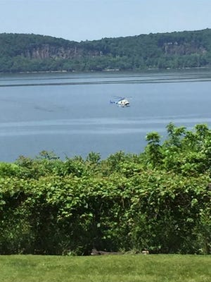 A helicopter searches for a possible drowning victim in the Hudson River near Croton Point Park on Tuesday.
