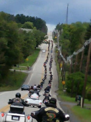 Motorcyclists form a long line down a road during a past Flight 93 Ride hosted by the Maryland chapter of the Leathernecks Nation Motorcycle Club.