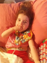 Ivy's hand is usually in her mouth, which is a telltale sign of Rett syndrome.
