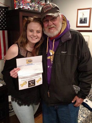 Ken Emerick, a former greeter at the South Hanover Walmart, presented Rebecca Plummer with a check for the Southwest Student Council Mini-THON on Feb. 15, 2017. Plummer started a petition and collected funds for Emerick after he was fired in January.