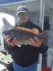 Pete Talevi, Ewing, with a blackfish he caught on the Norma K III.