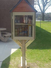 A Park Pantry created by Rianna Fust and Samantha Hanson stands outside the Schofield City Hall.