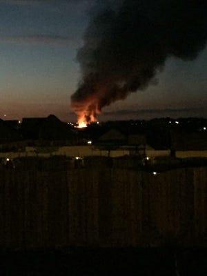 Smoke rises from a fire Saturday night at 17101 Korff Road on Saturday night.