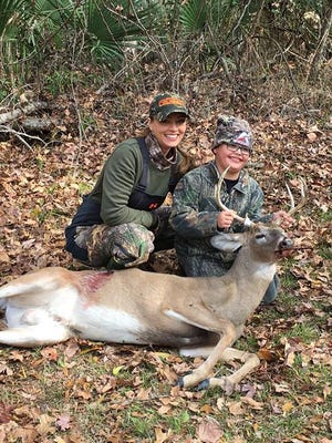Krystle Mahoney on left and Braxton Mahoney on right with Braxton's first buck at the Tensas NWR youth lottery hunt in December 2016