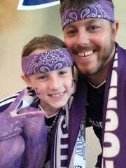 Louisville City FC fan Ryan Daring and his daughter Alaina Daring, 9. The Darings travel to Louisville City games from Fort Wayne, Ind.