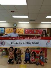 Humke Principal Jon Spehn and Desirae Schuh help some