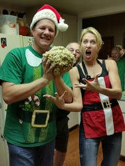 My sister and our brother-in-law posing with their giant cookie ball, something she always did on our annual cookie-baking day.