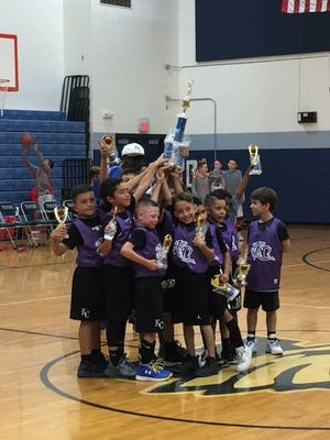The Kings of the Court celebrate their win.