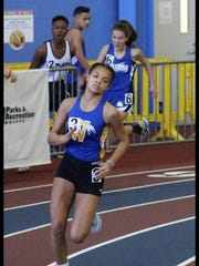 Brianna Stevenson competes for Wi-Hi in an indoor track
