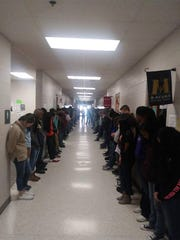 Students at Crockett County Middle School line the hallway for a voluntary prayer service for Wesley McCall on Friday, two days before he passed away.