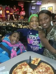 Tochmirra and her sisters, Tailiyah and Diamond, enjoy