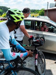Unity Ride cyclists Jonathan Williams and Andre Block talk with locals on their trip to Huntsville, Ala.