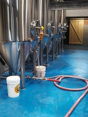 Fermenters at the Blue Collar Brewery in Poughkeepsie are key components in the business' craft-brewing process.