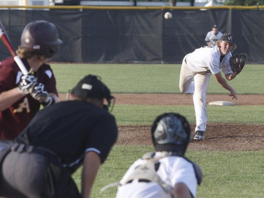 Ankeny Centennial's Reed Pegram pitches during the second game of Wednesday's doubleheader against visiting Ankeny. Pegram tossed a six-hitter and had 10 strikeouts as the Jaguars completed a sweep with a 6-1 win.
