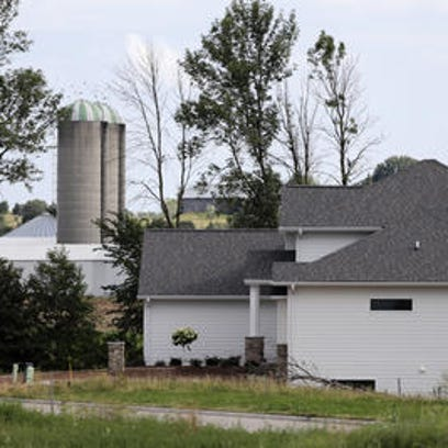 Farm's growth puts it in conflict with neighbors