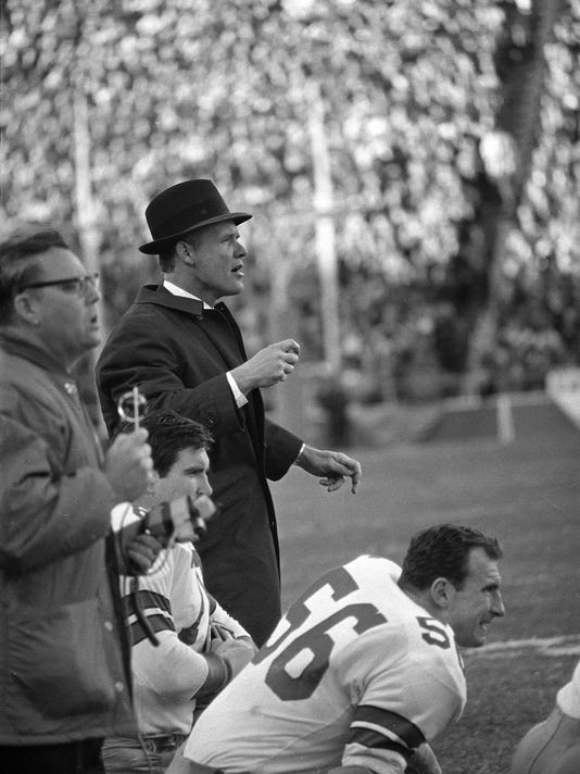 FILE - In this Jan. 1, 1967, file photo, Dallas Cowboys coach Tom Landry shouts to his players on the field during the NFL championship game against the Green Bay Packers in Dallas. The Packers won 34-27. Packers-Cowboys has been one of the NFL's most entertaining and meaningful rivalries for decades. (AP Photo, File)