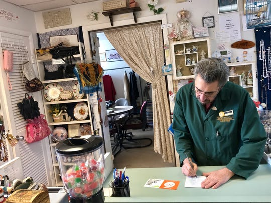 Leonard DiMenna has a roomful of donations to inventory each day at the Bargain Barn in Denville.