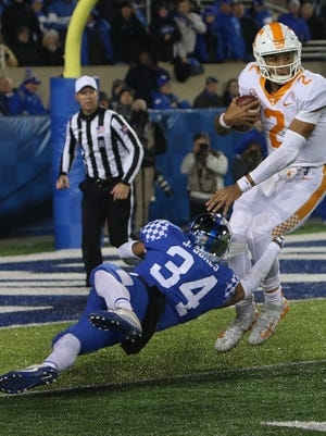 University of Kentucky's Jordan Jones just gets a hand on Tennessee's Jarrett Guarantano for a loss, during Saturday nights's game against Tennessee.