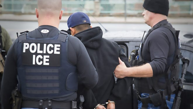 Immigration and Customs Enforcement officers detain a suspect during an enforcement operation on Feb. 7, 2017 in Los Angeles, California.