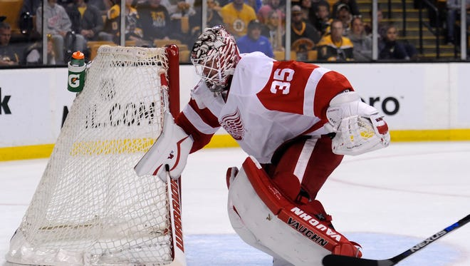 Sep 28, 2015; Detroit Red Wings goalie Jimmy Howard (35) handles the puck during the first period against the Boston Bruins at TD Garden.