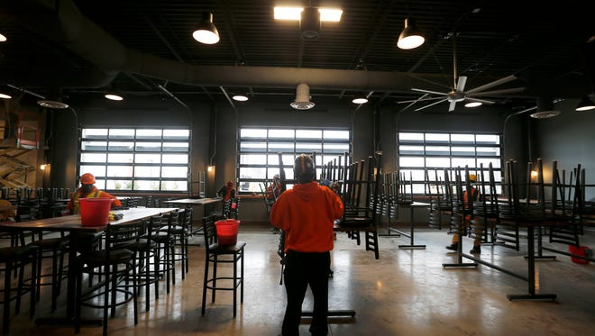 The finishing touches are made at the Taproom of MadTree's new brewery on Madison Road in Oakley Monday January 23, 2017.