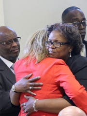 Former U.S. Rep. Gabby Giffords hugs Robin Brinkley-White, whose son was shot and killed, during an event in Wilmington on Monday. Giffords, who was wounded during a shooting in Arizona, was in Delaware to help launch a new effort to combat gun violence.