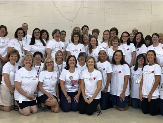 Staff at Homer Brink Elementary School, where Amy Root