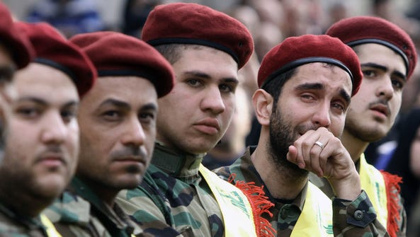 Hezbollah fighters mourn during the funeral of Mohammed