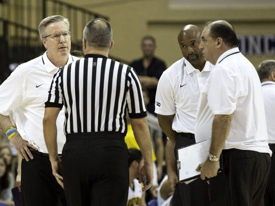 Iowa head coach Fran McCaffery, left, talks with the referee during the second half of an NCAA college basketball game against Wichita State, Sunday, Nov. 29, 2015, in Orlando, Fla. (AP Photo/Willie J. Allen Jr.)
