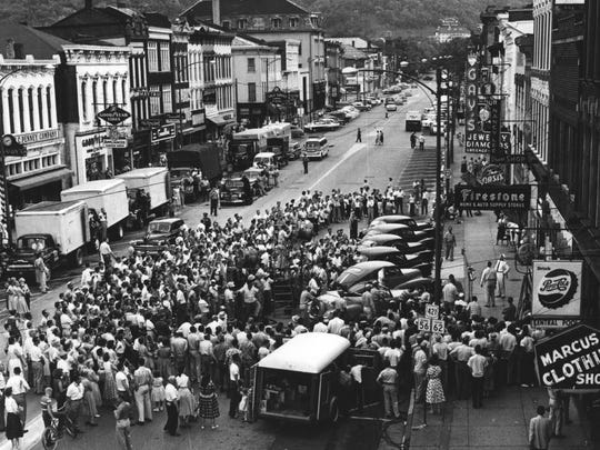 """Madison (Indiana) residents gathered in 1958 to watch filming of """"Some Came Running""""."""