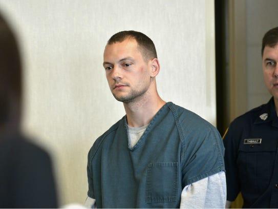 Lucas Gingras, 30, of Milton walks into the courtroom