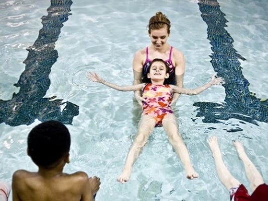 Instructor Cassie Ferlitch helps Alexandria Insley get comfortable floating on her back as Adam Todosyevik, Justin Rogers and Aaron Tomalino look on during a learn to swim lesson at the Southern Branch YMCA in Shrewsbury on Tuesday, March 26, 2013. The program is free to second grade students in the Southern School District. FOR THE DAILY RECORD/SUNDAY NEWS -- JEFF LAUTENBERGER Jeff Lautenberger