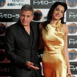 Actor George Clooney (L) and his wife Amal Clooney pose during the premiere of Clooney's latest film 'Tomorrowland' in Tokyo, Japan, on May 25, 2015.