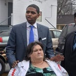 """Attorney Chadrick Mance stands with his client Penny Nelson during a press conference today reacting to the grand jury's decision on the death of Nelson's son, Charles Smith, who was shot and killed while handcuffed, by a police officer in September 2014. in Savannah, Ga. A grand jury last week concluded the shooting was justified, saying evidence showed Smith moved his cuffed hands in front of his body and grabbed a gun police missed patting him down. Nelson says she believes """"there was a cover-up down the line"""" to protect the officer."""