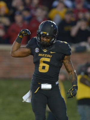 Missouri Tigers running back Marcus Murphy (6) celebrates after scoring during the second half against the Arkansas Razorbacks at Faurot Field.