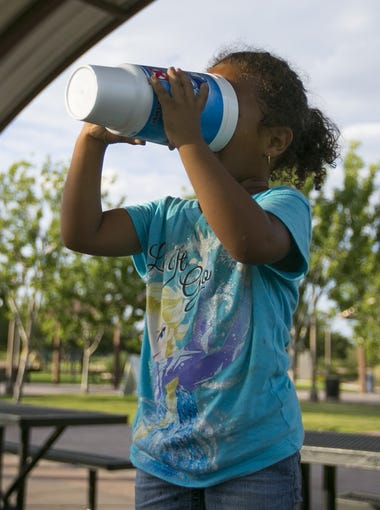 Guadalupe Fregoso, 4, chugs a cold drink in the record