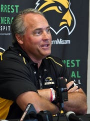 Southern Miss head football coach Jay Hopson answers questions during media day on Saturday.