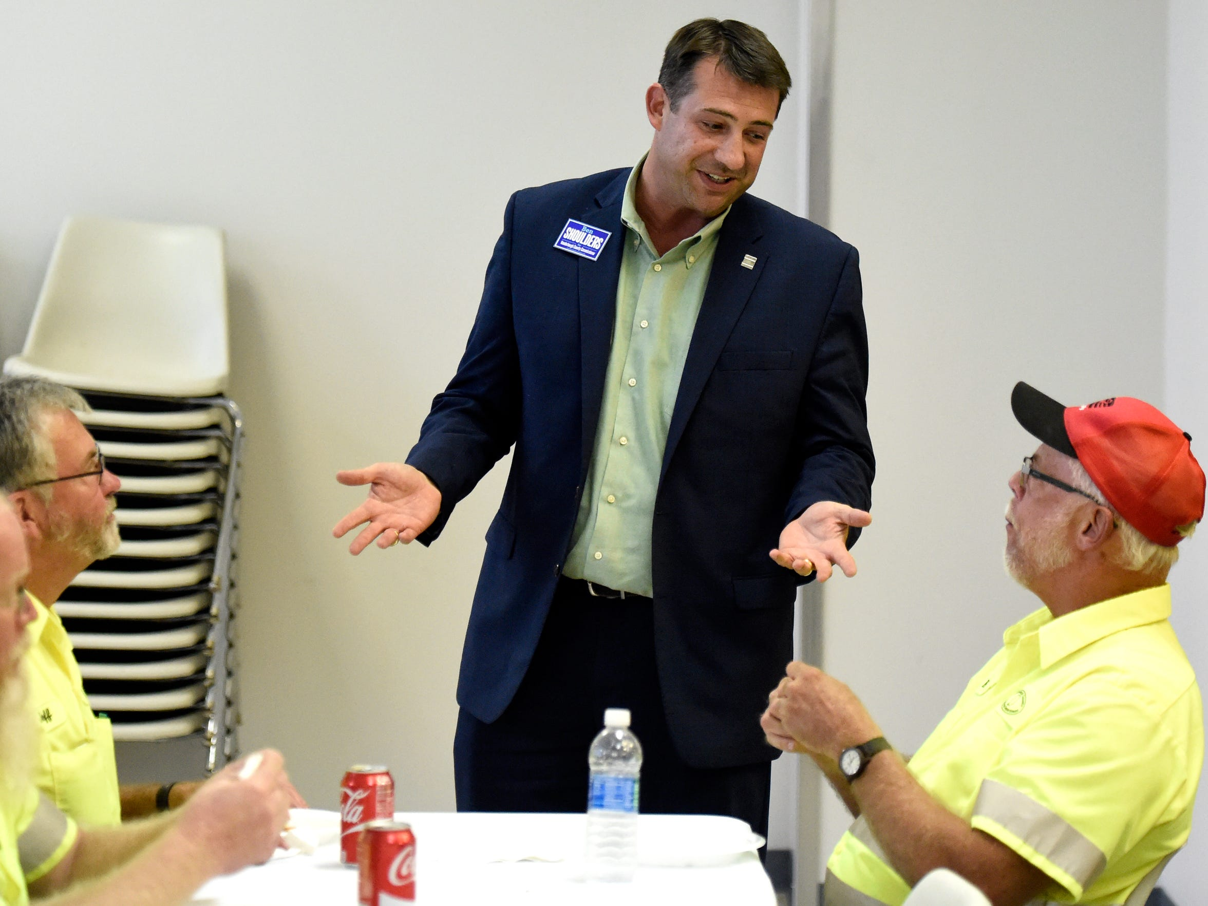 Vanderburgh County Commissioner candidate Ben Shoulders chats with Kirk Humphrey while visiting with workers at the Teamsters Local 215 headquarters in Evansville recently.