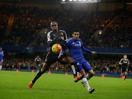 Chelsea's Pedro, right, competes for the ball with Watford's Allan Nyom during the English Premier League soccer match between Chelsea and Watford at Stamford Bridge stadium in London, Saturday, Dec. 26, 2015.  (AP Photo/Matt Dunham)