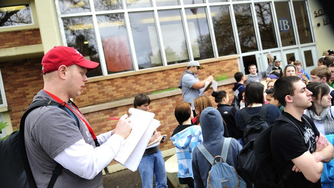 Jason Niedermeyer leads South Salem High School students to a science expo at Willamette University.