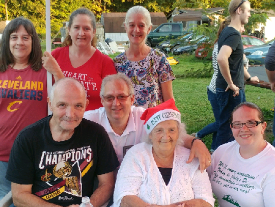 Judy Darr, wearing a Christmas cap, with her family