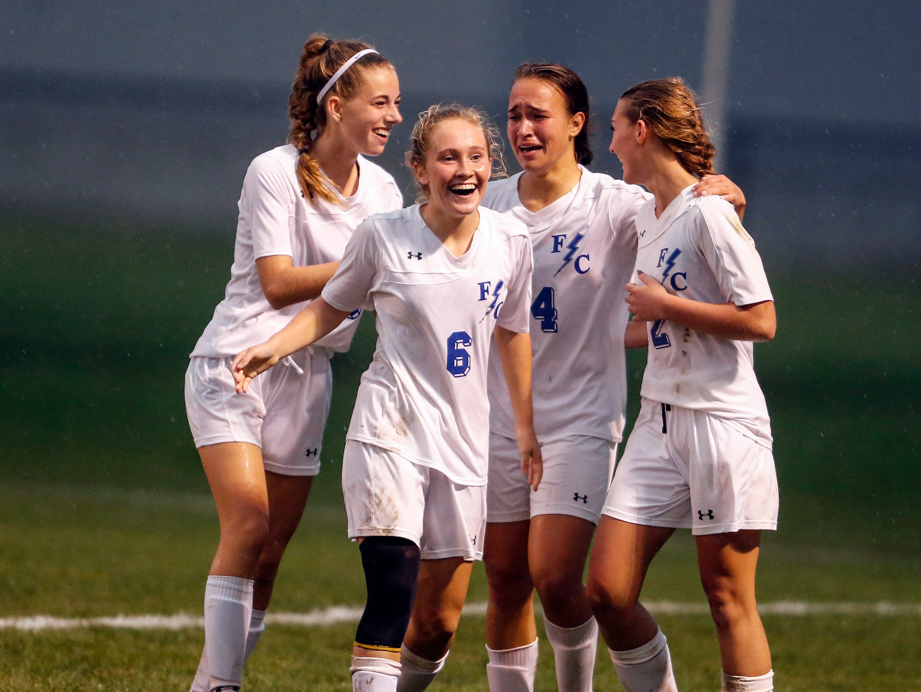 Franklin Central Savannah Kellum (second from right) is congratulated by teammates after scoring the winning goal in overtime in their semi-final game against Center Grove in the Shelbyville Regional on October 12,2016.