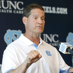 Gene Chizik fully embraces stress-free life, with family, without football